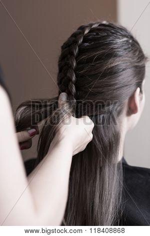 Hairdresser Making A Dutch Braid