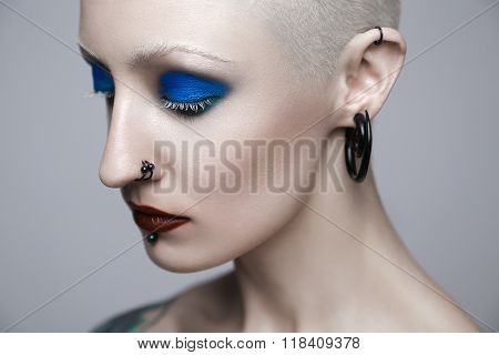 Makeup And Beauty Topic: Punk Girl With Blue Eyes And Red Lips On Gray Background In Studio