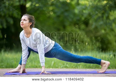 Easy Variation Of Utthan Pristhasana Pose In Park Alley
