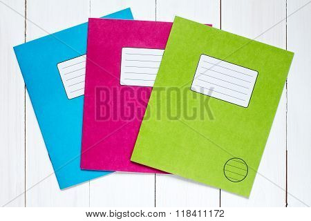 Three Colored Exercise Books