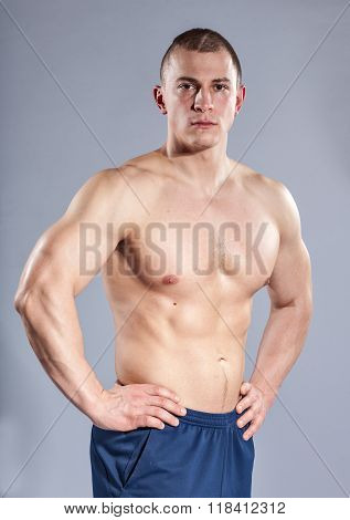 Muscular Young Topless Man On Gray Background