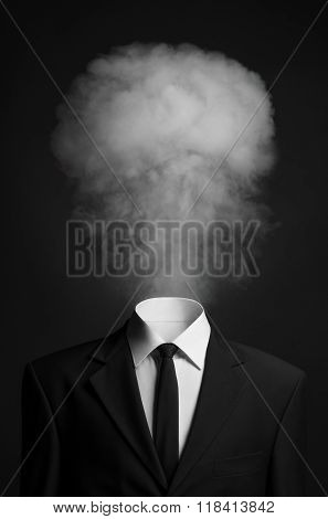 Surrealism And Business Topic: The Smoke Instead Of A Head Man In A Black Suit On A Dark Background