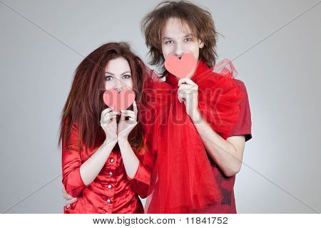 Girl And Boy Holding Paper Hearts