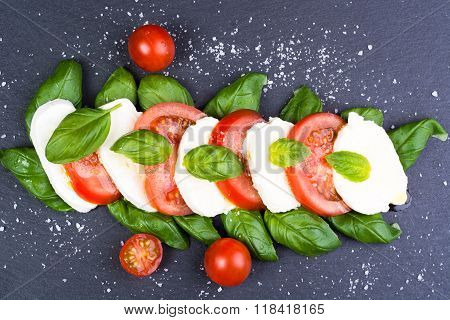Fresh Italian Caprese Salad On Dark Slate Background