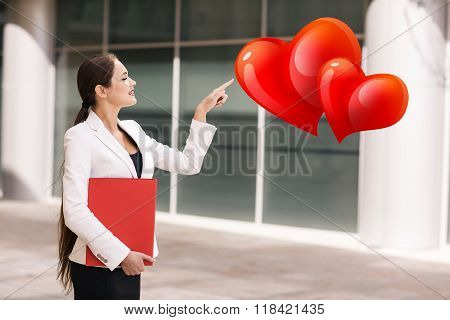 Business woman point on the red hearts