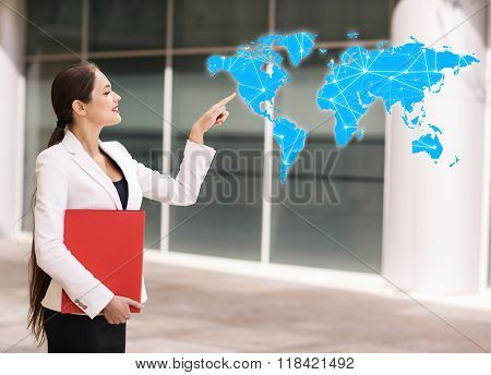 Business woman point on the blue map