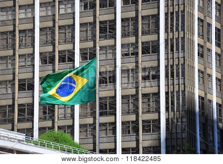 Brazilian Flag With Building In Background