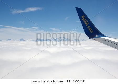 An Aircraft Wing Over Clouds