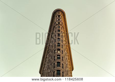 Low Angle Architectural Exterior View of Upper Floors of Historic Flatiron Building in Warm Afternoon Sunlight, Manhattan, New York City, New York, USA