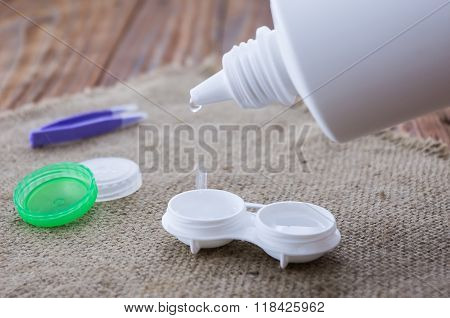 The Opened Lens Container Filled With Saline For Contact Lenses