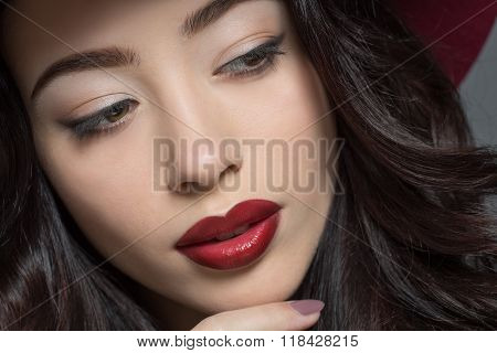 Fashion model woman with dark red hat on
