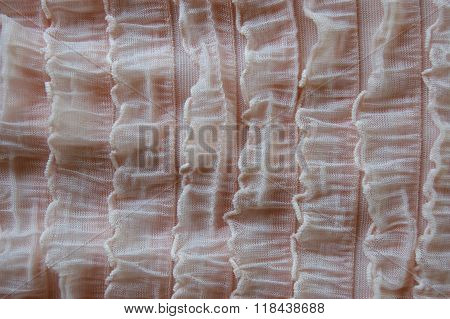 Pink ruffled material texture close up background