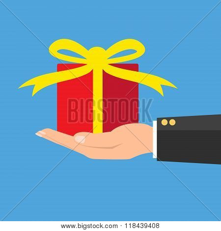 Red Gift Box In Hand Wrapped With Pink Ribbon On Green Background. Vector Illustration Conceptual Gi