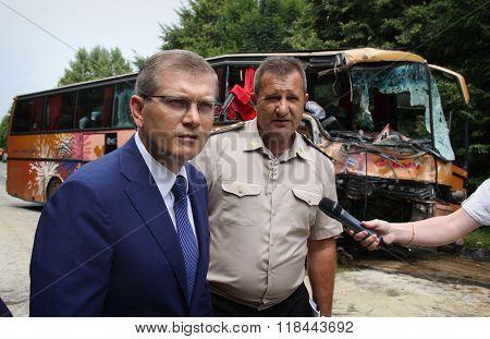 KOVEL UKRAINE - JULY 11: Vice Prime-Minister of Ukraine Oleksandr Vilkul (left) at place of bus crash where nine Ukrainian Belarusian and Bulgarian Tourists were died and as many as 30 others were injured July 11 2013 just outside Kovel Ukraine.