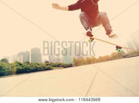 closeup of one young skateboarder skateboarding at city