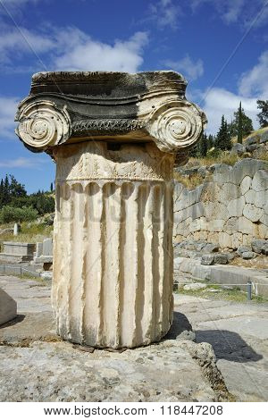 Ancient column in Ancient Greek archaeological site of Delphi, Greece