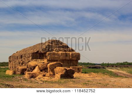 Closeup Large Industrial Haystack In Country In Spring