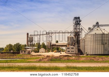 Production Yard And Metal Tank Of Modern Silo In Countryside