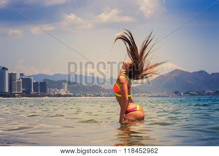 Blonde Girl In Bikini Stands In Sea Shaken Head Lifts Hair Up