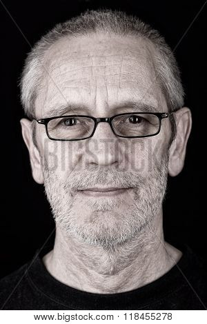 Portrait Of A Satisfied Man Wearing Glasses