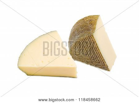 Two Pieces Of Spanish Cheese On A Light Background
