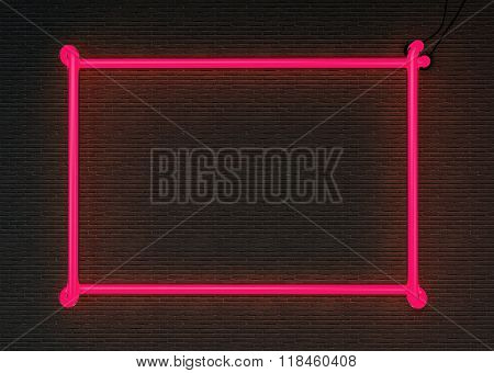 Pink neon frame isolated on black brick wall background