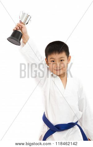 Asian Little Karate Boy Holding Cup In White Kimono