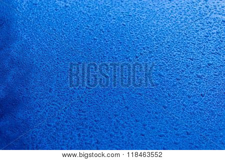 Waterdrops On Blue Car Paint As Underground, Shallow Focus