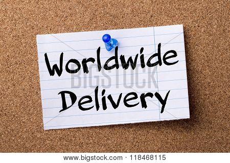 Worldwide Delivery - Teared Note Paper Pinned On Bulletin Board