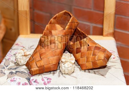 National Russian Bast Shoes On Brick Background