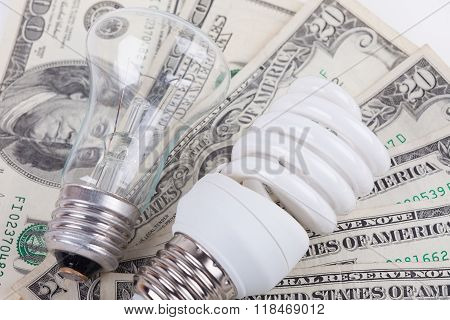 energy saving, traditional lamps and dollars closeup