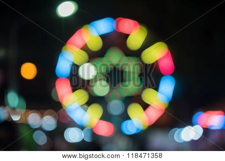 Defocused of Ferris wheel for background and texture