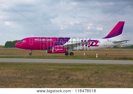 BUDAPEST, HUNGARY - SEPTEMBER 15, 2014: Wizzair A320 taxiing at Budapest Liszt Ferenc Airport, Budapest is one of Wizzair's most important bases.