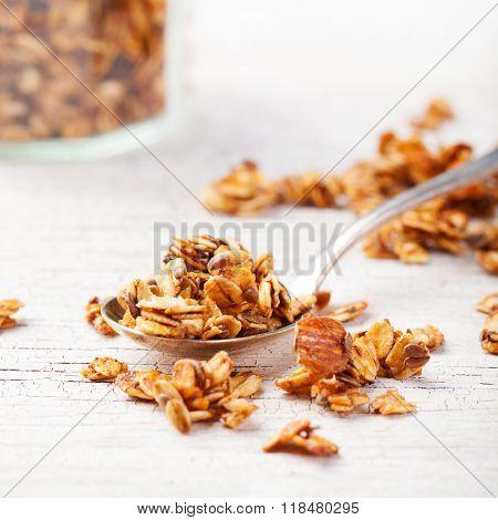 Healthy breakfast. Fresh granola, muesli in a glass jar Organic oat, almond Copy space