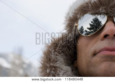 Man wearing a deerstalker hat and sunglasses