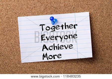 Together Everyone Achieve More Team - Teared Note Paper Pinned On Bulletin Board