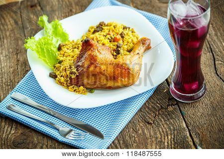 Tasty Dishes From Chicken Thigh With Rice And Lettuce And A Glass Of Juice With Ice