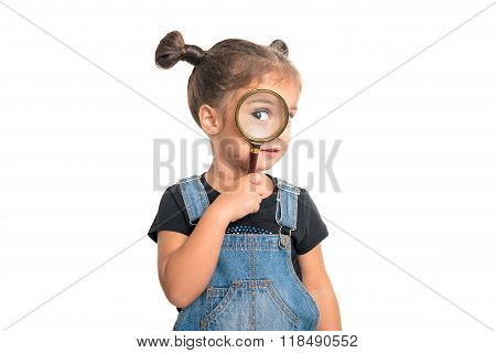 Cute Baby Girl  Looking  Through A Magnifying Glass