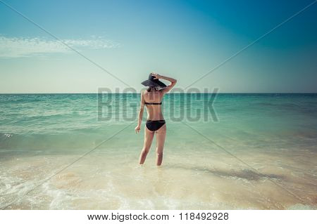 Woman on Caribbean coast, white sand, colombia, caribbean sea, walking woman