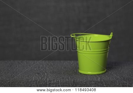 Small Green Pail On Gray Background