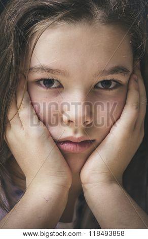 Closeup portrait of a sad little girl