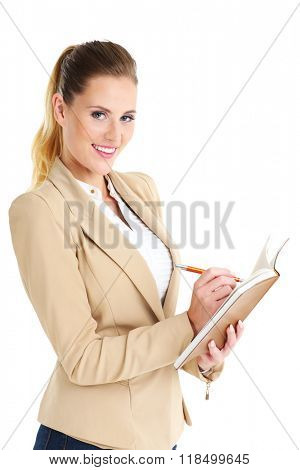 Picture of businesswoman with agenda over white background
