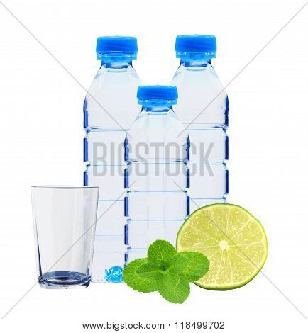 Blue Bottles With Water, Mint Herb And Fresh Green Lime Isolated On White
