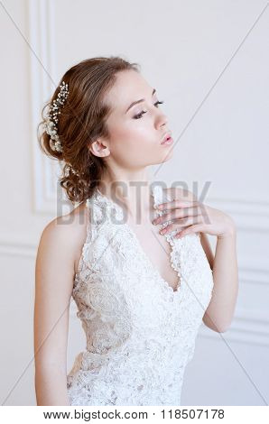 Young Adult Caucasian Bride Demonstrating A White Bridal Gown