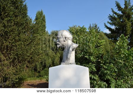 Old monument to Lenin. A concrete bust of Lenin near recreation center in the rural settlement.