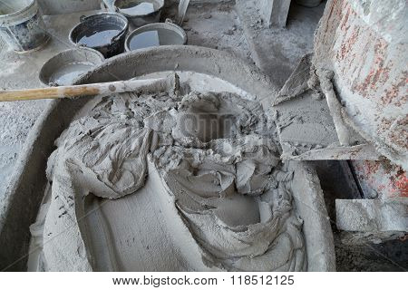 Mixing A Cement In Salver For Construction