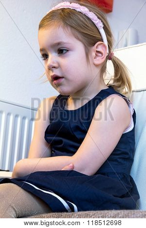 Cute Blond Girl, 4 Years Old, Watching Cartoons On A Pc