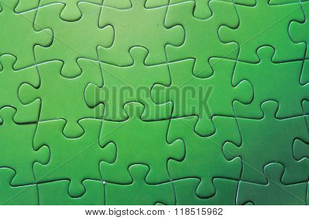 Detail of green puzzle pieces put together