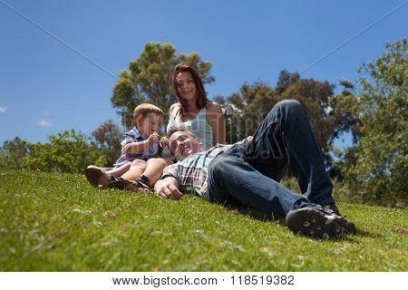 Young Family Relaxing Outdoors