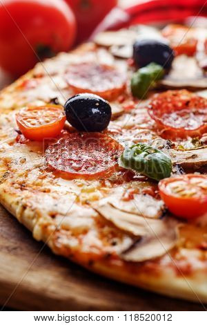 Close-up Of Delicious Fresh Pizza With Mushrooms, Cherry And Pepperoni Served On Wooden Table.